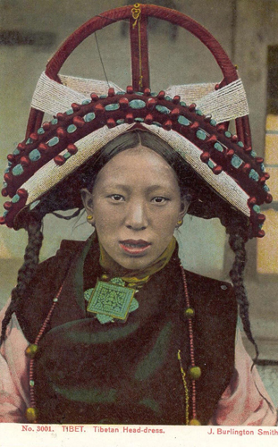 Tibetan lady with stunning traditional headdress jewelry and costume