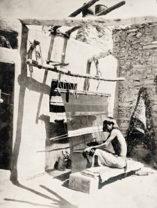 A Pueblo man weaving at a loom. ca. 1900. Source - Princeton